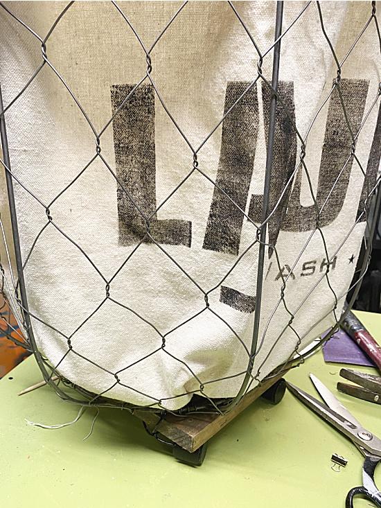 stenciled bag inside basket