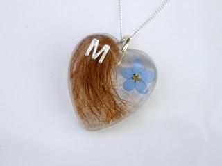 Personalised hair and flower keepsake pendant