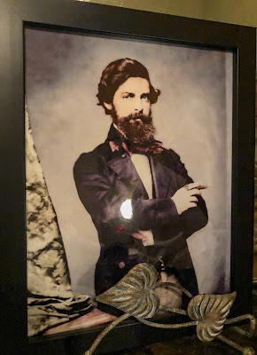 Photo of Valsin Marmillion on display at San Francisco Plantation.
