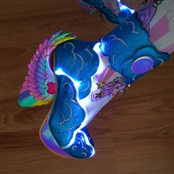 close up of light up shoes with winged heel