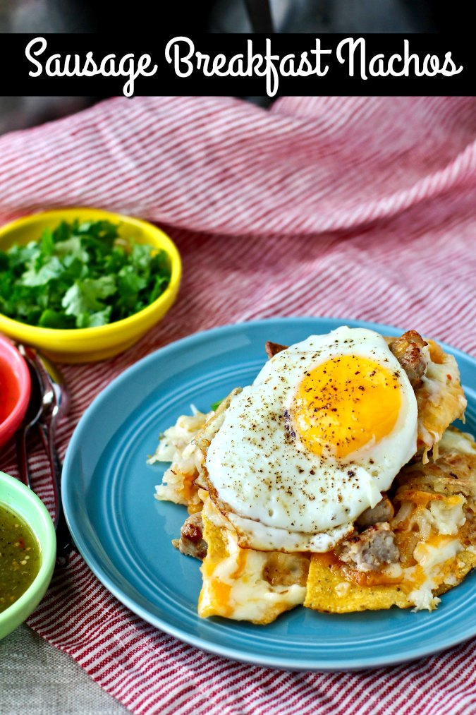 These breakfast nachos are loaded with hash browns, sausage, two kinds of cheese, jalapeños, and topped with fried eggs.