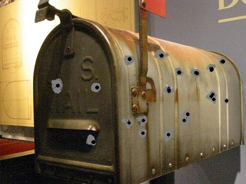 Bulletholes In the Mailbox