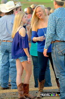 Cutoff jeans & short flouncy skirts are most  common attire for young women at Calf Fry Photo by Jerome Shaw for Travel Boldly