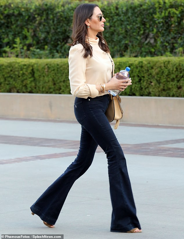 Lauren Silverman sports flared denim and chiffon blouse out in LA