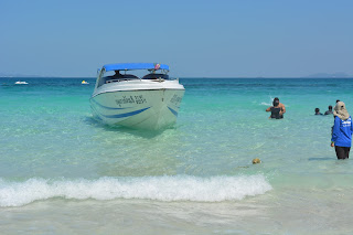 Speed boat at coral Island