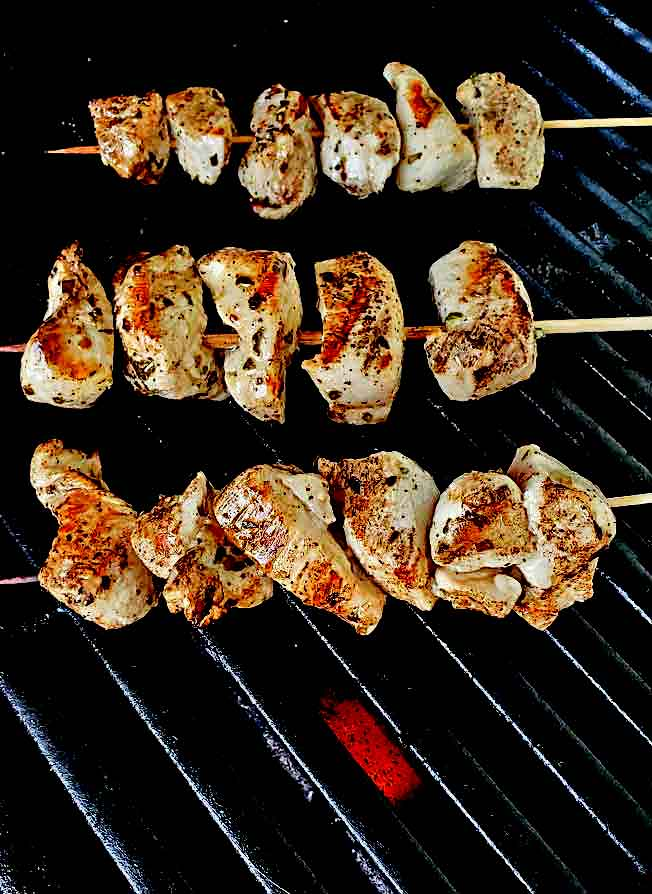 grilled chicken Greek marinated chicken on a weber grill with flame