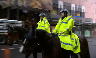 Police on horseback and  foot to Protect the Statue of British Explorer in Sydney