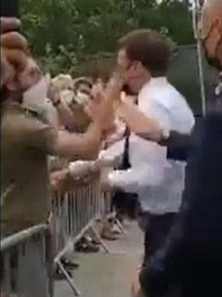 Macron receives heavy slap in face during walkabout in southern France (video)
