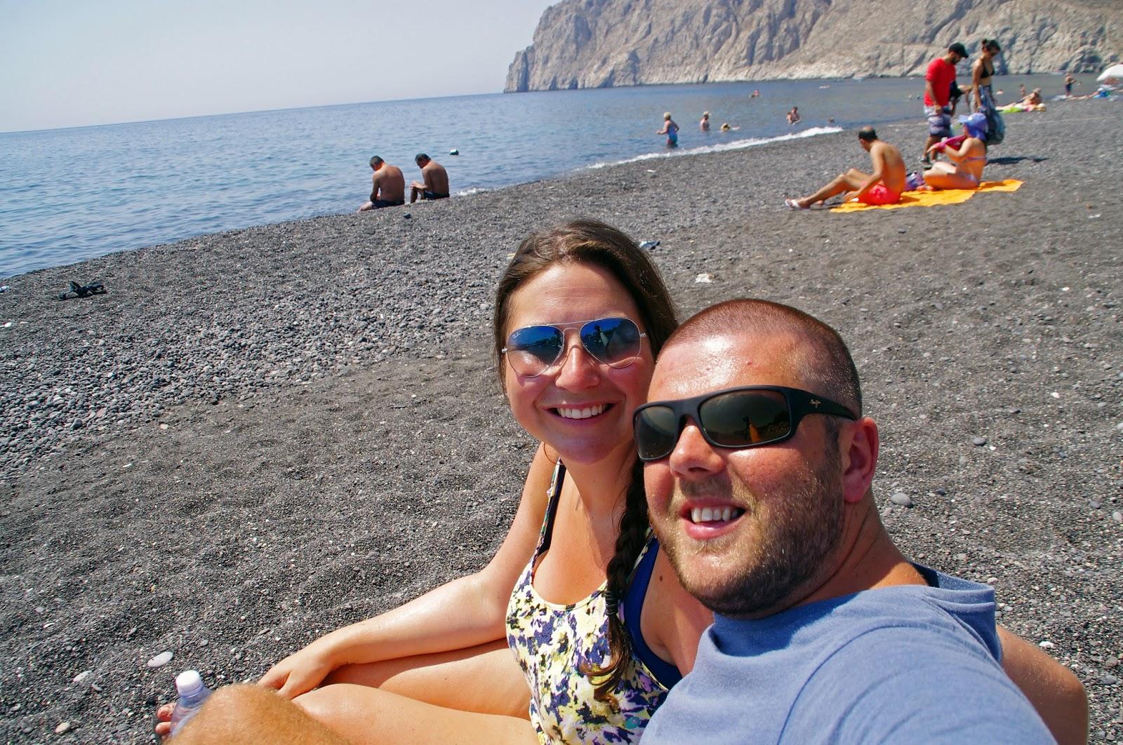 Couple on Black Sand Beach Santorini