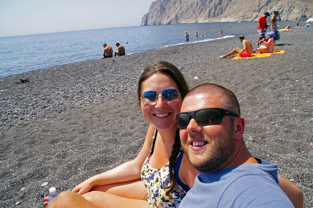 Couple on Black Sand Beach Santorini