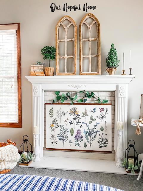 faux fireplace mantel display botanical print candles plants books
