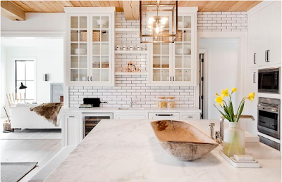 Black and white kitchen design marble island, whitewashed floors