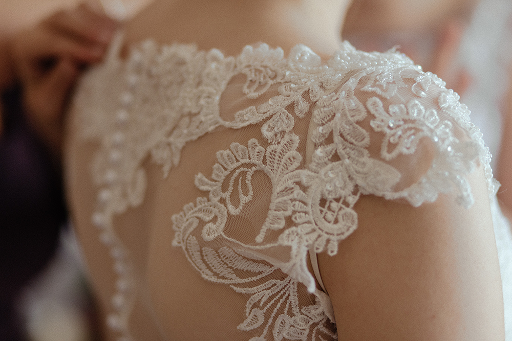 Close up of white lace top on a wedding dress