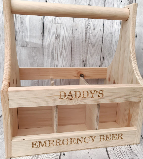 Wooden beer drug with 'Daddy's Emergency Beer' written on it