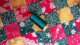 Metallic batiks quilted table topper