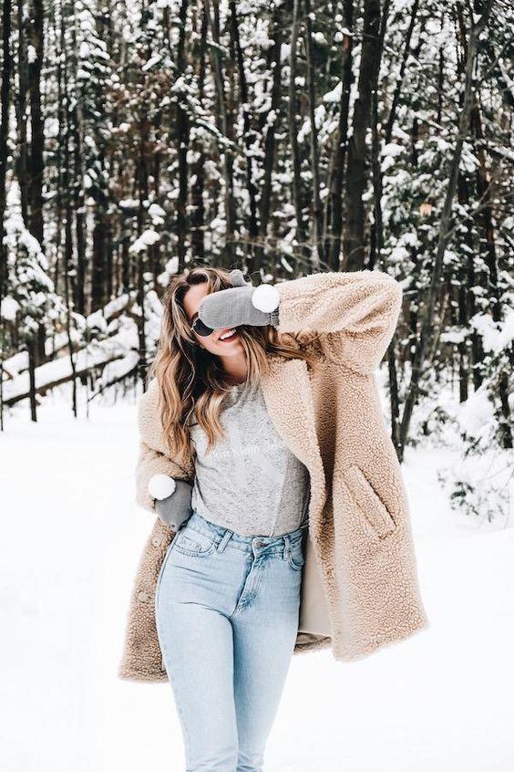 trendy winter outfit idea / nude fur coat + grey top + jeans
