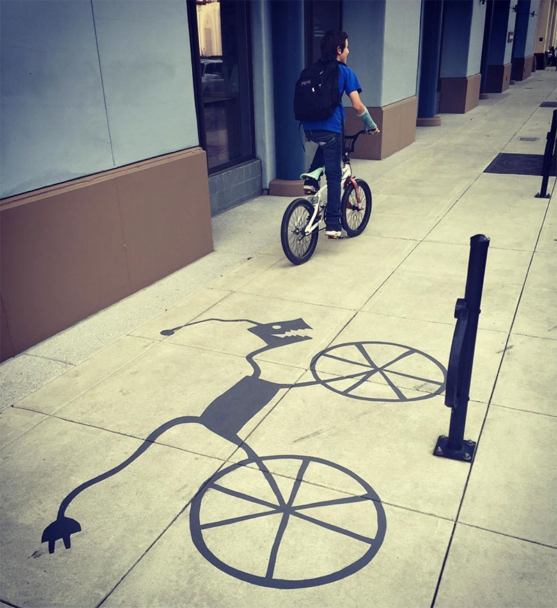 09-Bicycle-Rack-Damon-Belanger-Inventive-Surreal-Shadow-Paintings-come-Alive-www-designstack-co