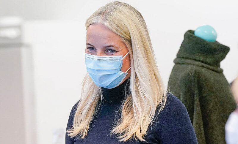 Crown Princess Mette-Marit wore a navy high-neck wool sweater and grey trousers
