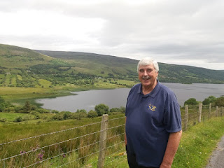 Fr. Ed O Connell with Glenade Lake in background