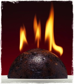 beautifully flaming christmas pudding