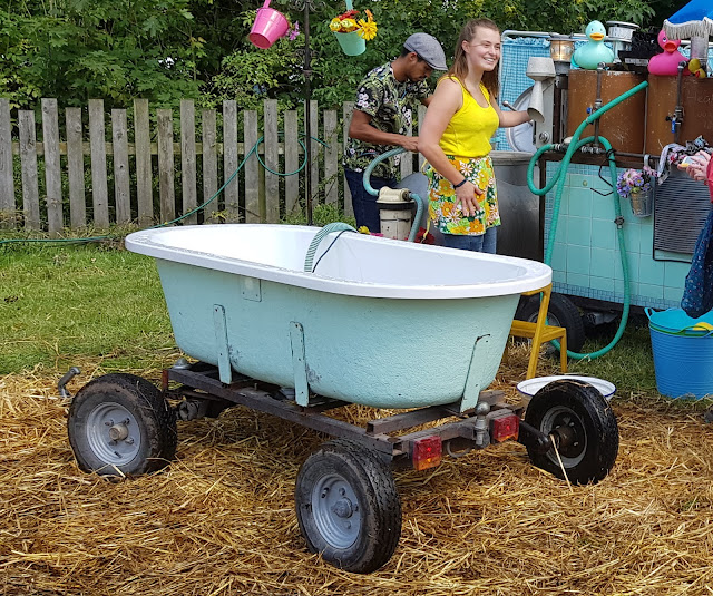 Just So Festival Mobile bathtub shown refilling and reheating the water between bathers