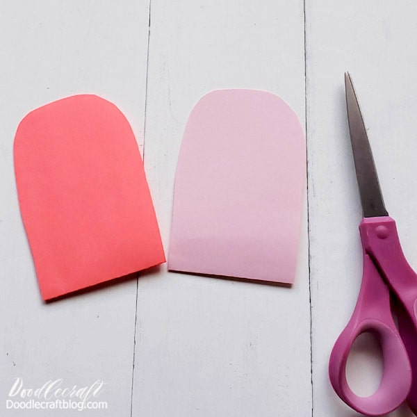 Keep the cut paper pieces folded in half.