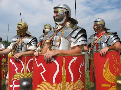 Reenactors from Legion III Cyrenaica with the armor and shields of a Roman legion.