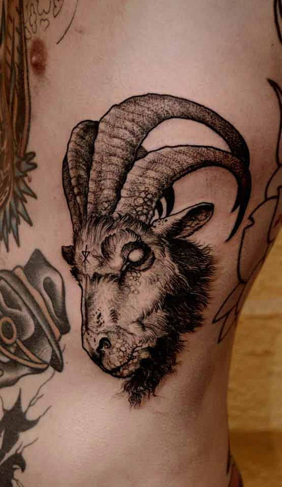 Capricorn symbol goat head tattoo on side rib.