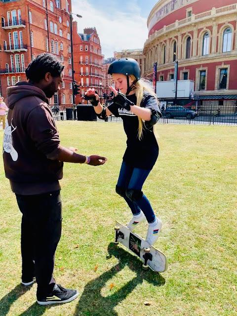 Skates & Ladders Instructor teaching a skateboard trick the pancake flip