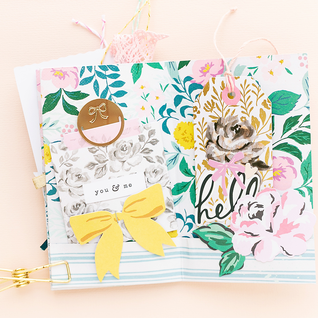 Pretty gift tags with bow, paper clips, and embellishments from the Garden Party Scrapbook Collection by Maggie Holmes