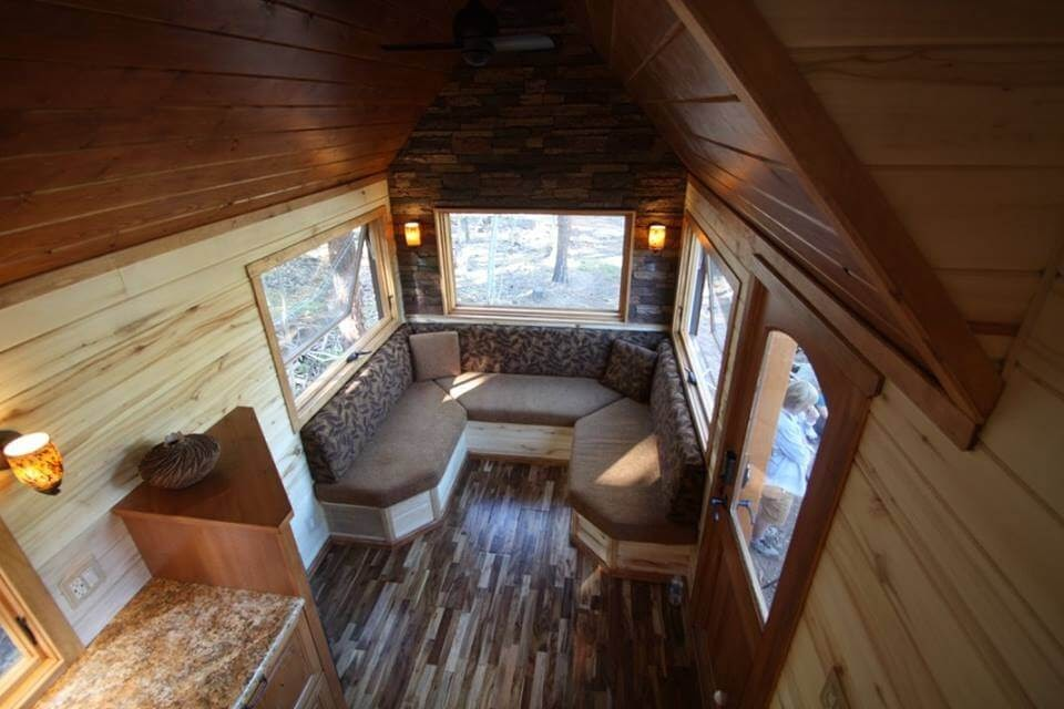 06-Living-Room-Simblissity-Tiny-House-Stone-Cottage-on-Wheels-www-designstack-co