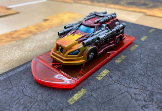 Image showing Car Wars miniatures on a road tile