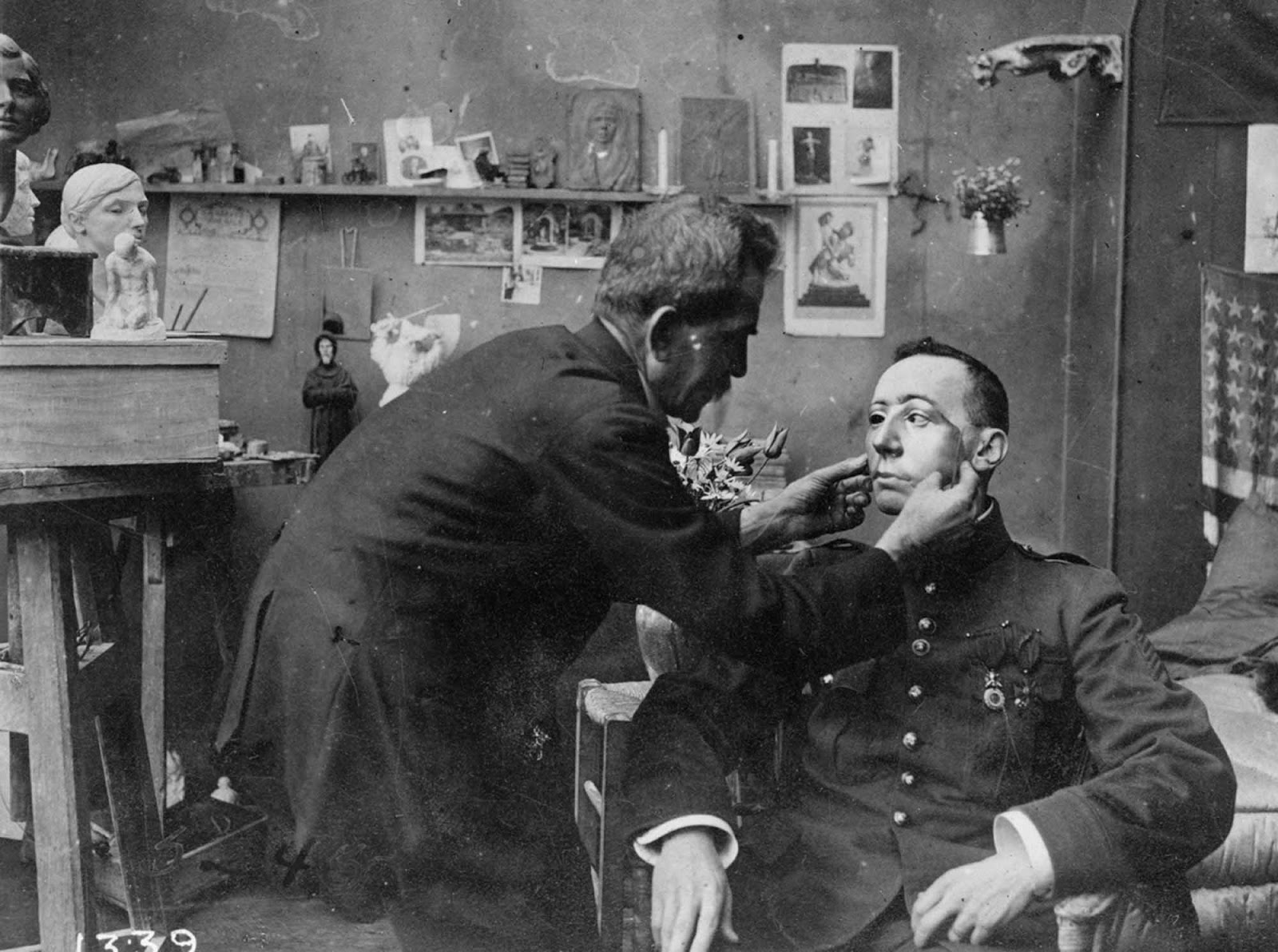French soldier whose face was mutilated in World War I, being fitted with a mask made at the American Red Cross studio of Anna Coleman Ladd, 1918.