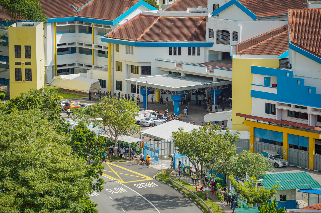 A long queue was formed at the screening centre at the former Bishan Park Secondary School, on 03 May 2021.