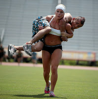 Muscle Girl shoulder girl lift and carry