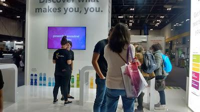 Visitors and reps at 23andMe stand