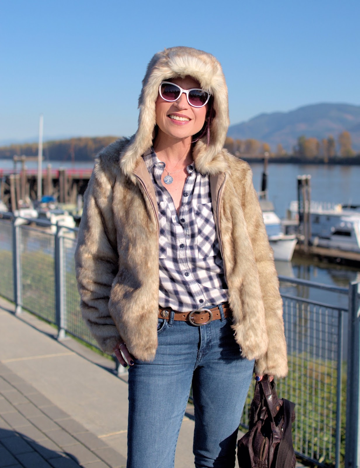 Monika Faulkner outfit inspiration - faux-fur hoodie, plaid flannel shirt, skinny jeans, white sunglasses