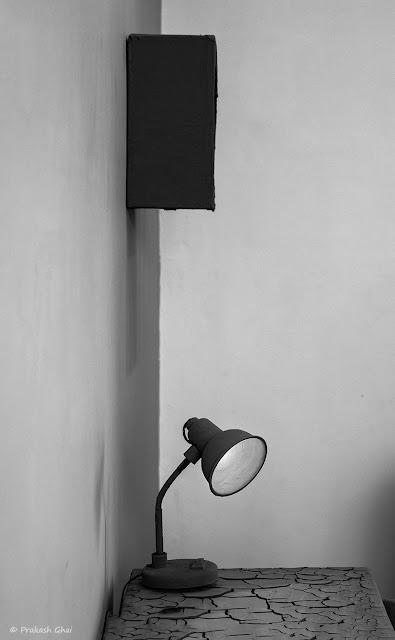 A Black and White Minimalist Photograph of a Table Lamp shot at Jawahar Kala Kendra, Jaipur.