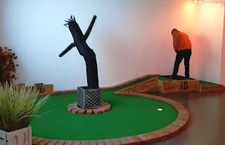 The Wacky Waving Inflatable Arm Flailing Tube Man on hole 10 at The Clubhouse Stoke minigolf course