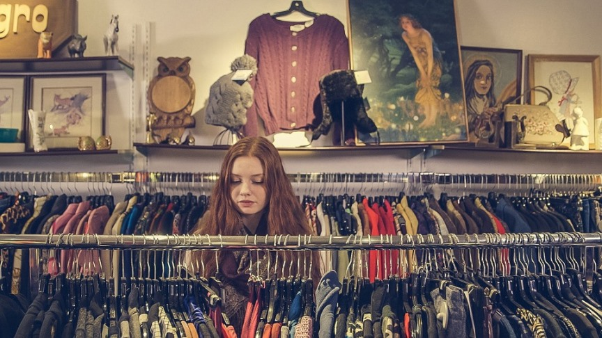 How to Eco-Shop to Save Money and Planet Woman Eco-Shopping At a Thrift Store