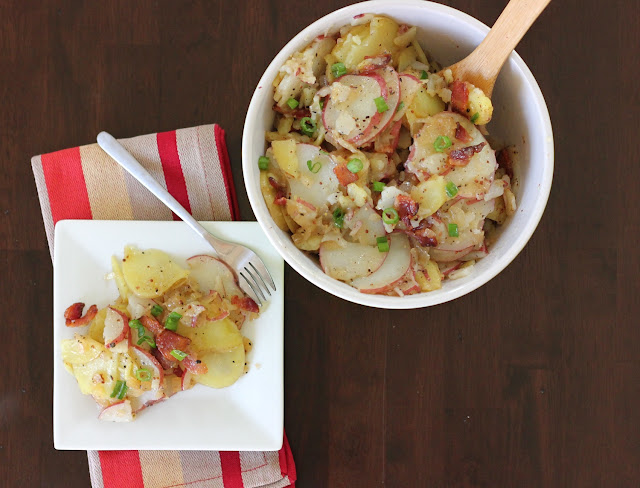 German Potato Salad, made with red potatoes and served from a large bowl.