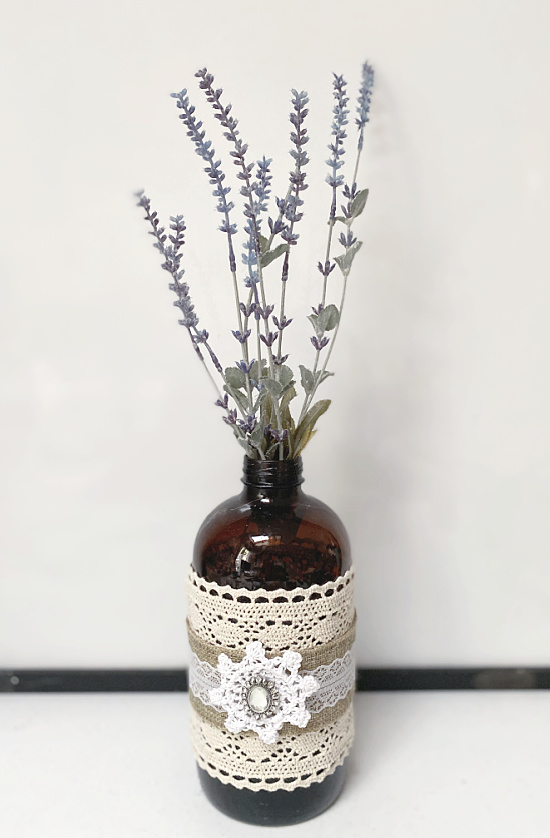 lace wrapped bottle with lavender