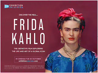 Frida Kahlo on a red background in a blue dress