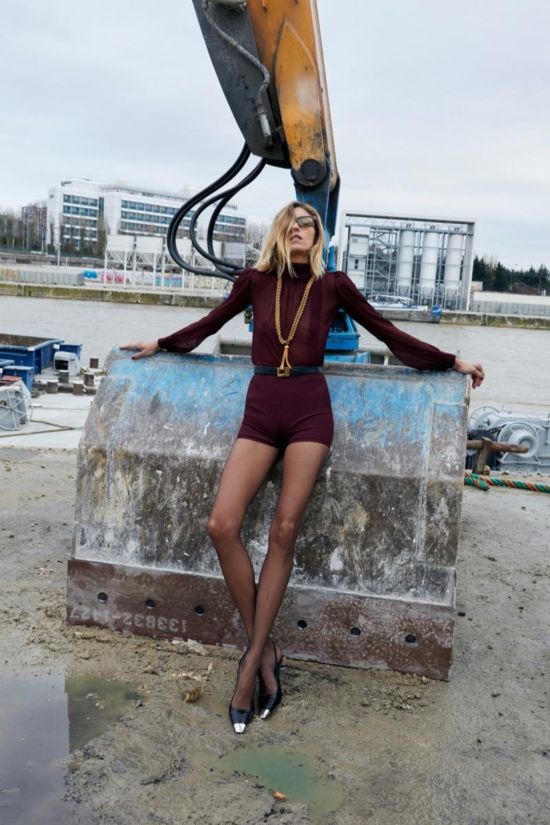 Anja Rubik poses in Paris for Saint Laurent summer 2021 campaign.