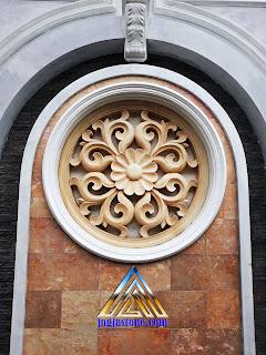 ukiran tempelan dinding bentuk bulat dari batu alam