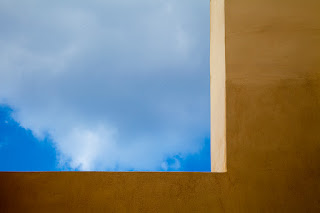 A window abstract with clouds on the beautiful island of Santorini.
