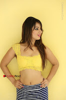 Cute Telugu Actress Shunaya Solanki High Definition Spicy Pos in Yellow Top and Skirt  0478.JPG