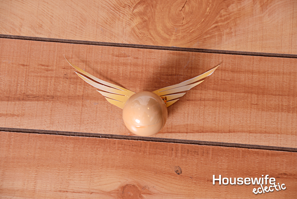 photo about Golden Snitch Printable titled Golden Snitch Ornament with printable wings - Housewife Eclectic