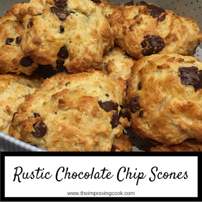 Close up of scones in a cake tin with text