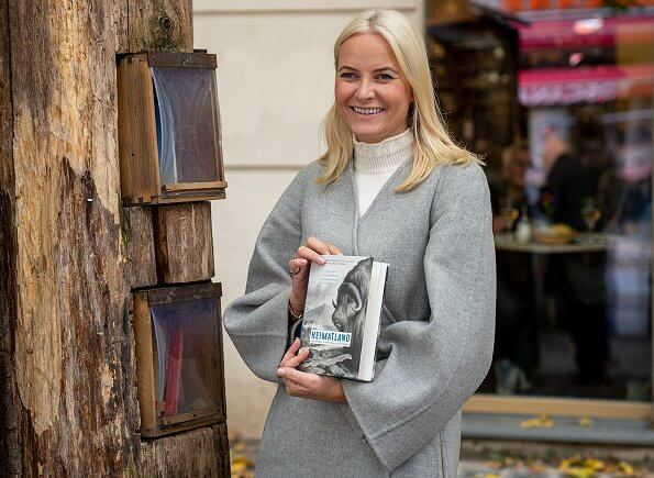 Crown Princess Mette Marit wore a grey wool coat by Chloe, and she wore white soft wool knit sweater by Co